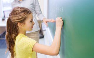 Elementary school student writing math problem